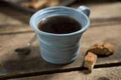 Blue Cup Containing Coffee or Tea with Spoon and Biscuits Royalty Free Stock Photo