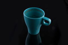 Blue cup after cup of coffee drunk Stock Photos