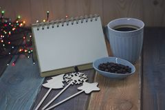 Blue cup and notebook on Christmas tablen Royalty Free Stock Images