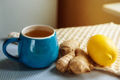 Blue cup of herbal tea with ginger and lemon. Food and drink concept Stock Images