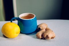 Blue cup of herbal tea with ginger and lemon. Healthy lifestyle Stock Image