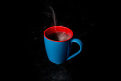 A Blue Cup of hot Steaming coffee black background Stock Photography