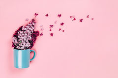 Blue cup with lilac flowers Royalty Free Stock Image