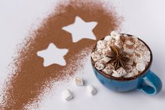 Blue cup with marshmellow cacao powder and star. royalty free stock photo