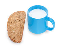 Blue cup with milk and slice rye bread grain. Isolated on white background Stock Photos