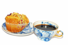 Blue cup and muffin. Stock Image