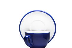Blue cup and plate. On white background royalty free stock images