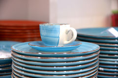 Blue cup and saucer with plates. There is a blue with white service: cup, saucer and some plates Stock Image