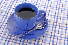 Blue cup of tea. On the the table stock photography