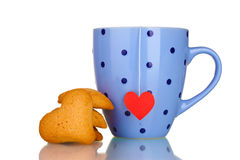 Blue cup with tea bag and heart-shaped cookies Stock Photos