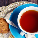 Blue cup of tea and cookies Stock Photography