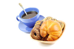 Blue cup with tea and croissant Royalty Free Stock Images