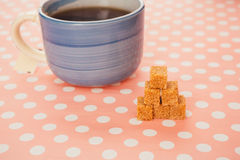 Blue cup of tea and lump sugar on pink background Stock Photography
