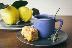 Blue cup of tea and quince apple pie Stock Photography