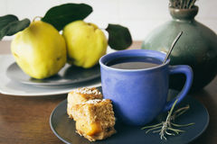 Blue cup of tea and quince apple pie Royalty Free Stock Photography
