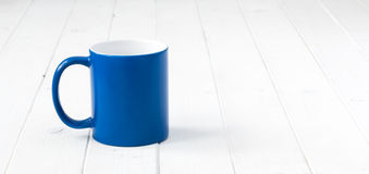 Blue cup with white inside Royalty Free Stock Images