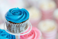 Blue Cupcake. Close up shot of blue cupcake on cupcake stand at birthday party with copy space royalty free stock photo