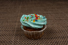 Blue cupcake with cream. Breakfast sweet tooth. Denim, fresh cupcake with blue cream and confectionery Topping Royalty Free Stock Photo