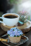 Blue cupcake design cream like blue Hydrangea flower Served with hot black coffee on wooden table background. And have some space for write wording Royalty Free Stock Image