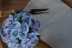 Blue cupcake design cream like blue Hydrangea flower Served on wooden tray with brown paper napkin and little fork. Have some space for write wording Royalty Free Stock Photos