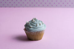 Blue cupcake With whipped cream, and heart Royalty Free Stock Images