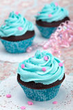 Blue Cupcakes. Chocolate cupcakes with blue buttercream frosting decoraed with pink sprinkles stock photos