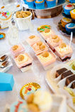 Blue cupcakes. Candy bar with blue cupcakes Stock Photos