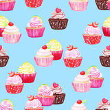 Blue cupcakes vector seamless pattern Stock Photos