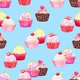 Blue cupcakes vector seamless pattern Stock Photos