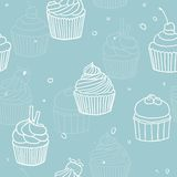 Blue cupckes pattern. Vector hand drawn seamless pattern Royalty Free Stock Photos