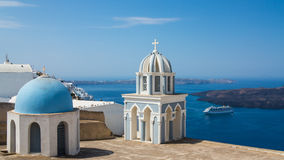 Blue Cupolas in Fira, Santorini. Two blue cupolas and the sea in Fira, Santorini, Greece royalty free stock images
