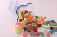 Blue cupping glass of candies. Blue cupping glass of colorful mix of candies Royalty Free Stock Photography
