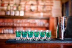 Blue curacao alcoholic cocktail shots on bar Stock Image