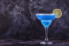 Blue Curacao cocktail decorated with fruit. stock photography