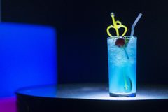 Blue curacao cocktail drink with cherry Royalty Free Stock Photos