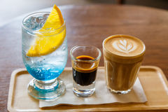 Blue curacao cocktail with espresso and coffee latte on wooden t Stock Images