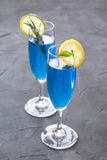 Blue curacao cocktail with rosemary, lime and lemon Royalty Free Stock Images