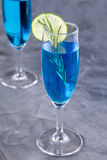 Blue curacao cocktail with rosemary, lime and lemon Royalty Free Stock Photo