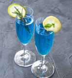Blue curacao cocktail with rosemary, lime and lemon Royalty Free Stock Image