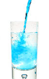 Blue curacao pouring into glass Stock Photography