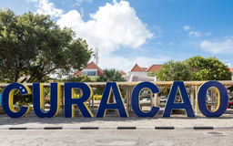Blue Curacao Sign. Huge blue sign spelling out Curacao in city park royalty free stock image