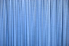 Blue curtain. The vertical blue curtain, blue background Royalty Free Stock Images