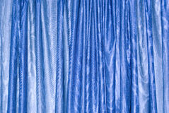 Blue curtain. Closed blue curtain background wallpaper Stock Photo