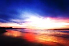 Blue curtain. Fantastic  daybreak at Hartenbos beachline with blue dark skies Royalty Free Stock Photo