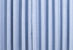 A blue curtain stock image