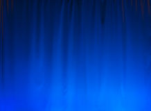 Blue Curtain background. Nice blue lighted curtain, great for a background Royalty Free Stock Images
