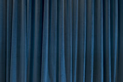 Blue Curtain for Backgrounds and Theater Themes Royalty Free Stock Photography