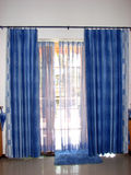 Blue Curtain Call. Beautiful blue curtains in a house Royalty Free Stock Image