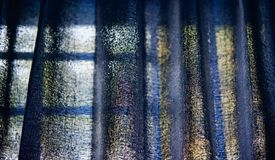 Blue curtain clothes of a window blurry background photo. Beautiful blueish clothes of a window curtain unique blurry background photo stock photography