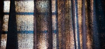Blue curtain clothes of a window blurry background photo. Beautiful blueish clothes of a window curtain unique blurry background photo stock photos